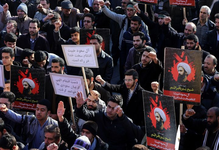Demonstrators hold posters of Nimr Baqir al-Nimr during a rally in Tehran against his execution by Saudi authorities.