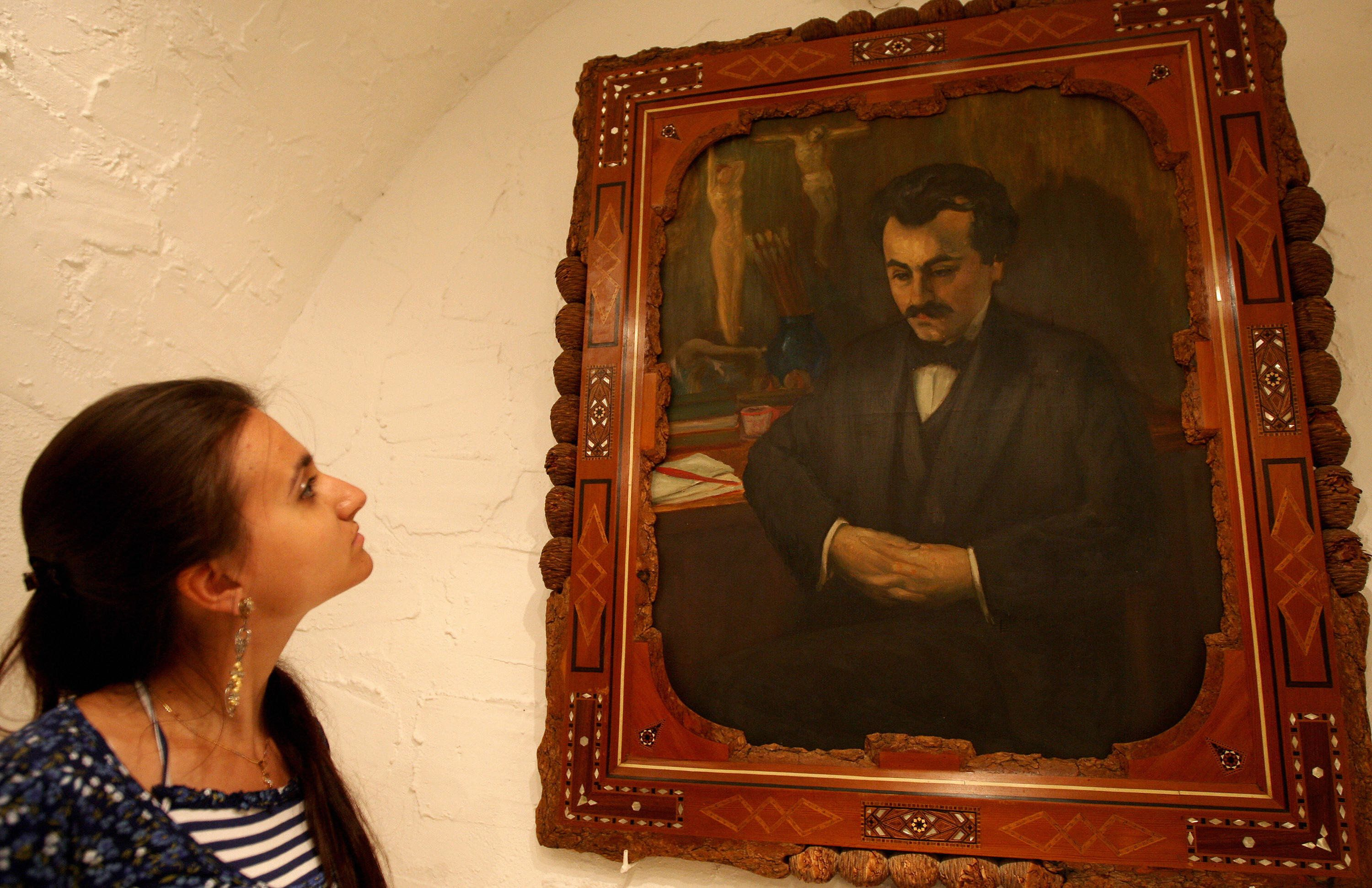 A self-portrait of Lebanese-American poet Kahlil Gibran hangs inhis home, now a museum, in the village of Besharre, Leb
