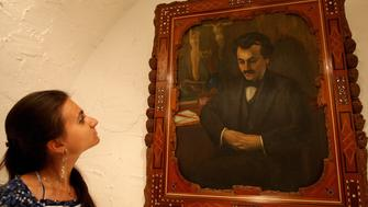 TO GO WITH AFP STORY BY RANA MOUSSAOUI A visitor looks at an auto-portrait of Lebanese poet and artist Gibran Khalil Gibran (1883-1931) at his house, now turned into a museum, in the northern village of Besharre on July 24, 2008. Gibran, who was born in Lebanon but spent most of his life in the United States, rose to fame following the release of his best renowned work 'The Prophet'. More than 70 years after his death, the poet continues to fascinate by his timeless humanism. AFP PHOTO/JOSEPH BARRAK (Photo credit should read JOSEPH BARRAK/AFP/Getty Images)