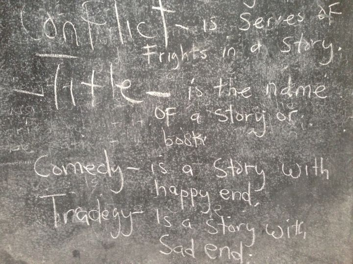 A blackboard displays a storytelling lesson at the M.V. Massaquoi School, a former Ebola holding center, in West Point,