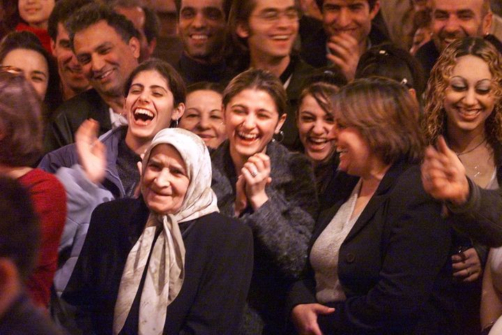 A large crowd reacts to dance contest at an Iranian Bazaar in honor of the Baha'i New Year, Naw-Ruz.