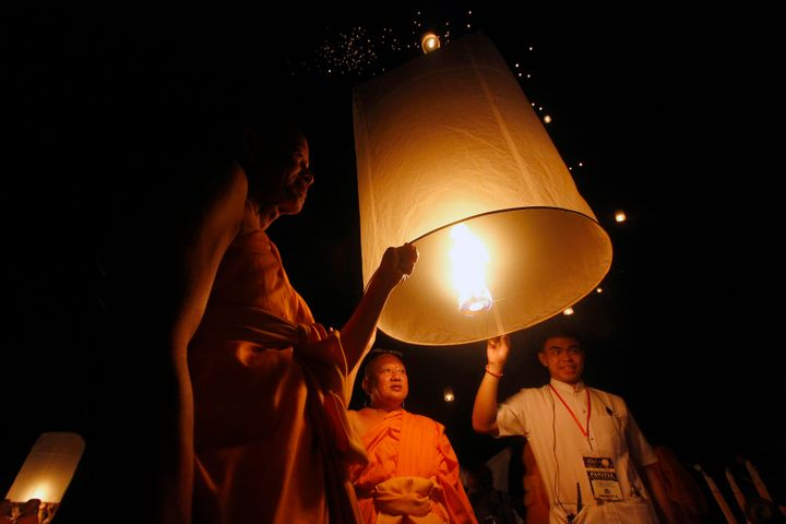 Buddhist followers release a lantern into the air at Borobudur temple during celebrations for Wesak Day.
