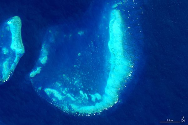 The letter J, as demonstrated by a satellite image of the Trunk Reef, off the coast of Queensland, Australia (July