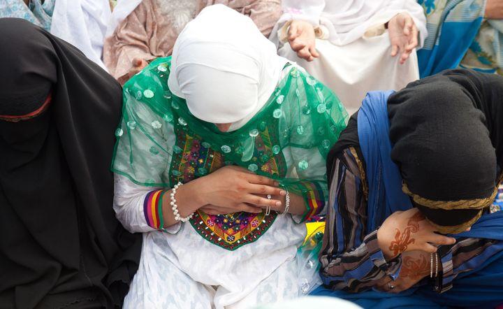 Muslim women offer congregational Eid-ul-Fitr prayers at Eid Gah in Srinagar, India.