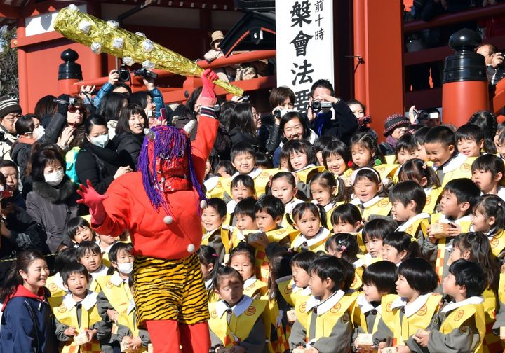 Children part in a traditional bean-throwing ceremony to drive away evil and bring good luck at the annual Setsubun Fest