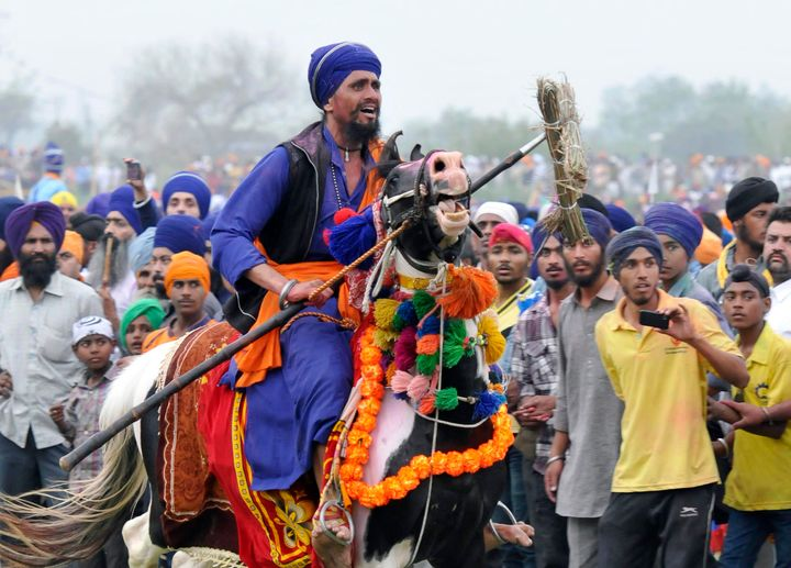 Sikh soldiers participate in a horse riding competition during Holla Mohalla celebrations in Anandpur Sahib, India.
