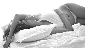 Beautiful woman lying on a bed