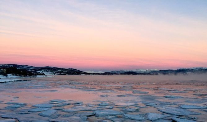 A photograph of frozen water during the polar night in Tromsø, Norway.