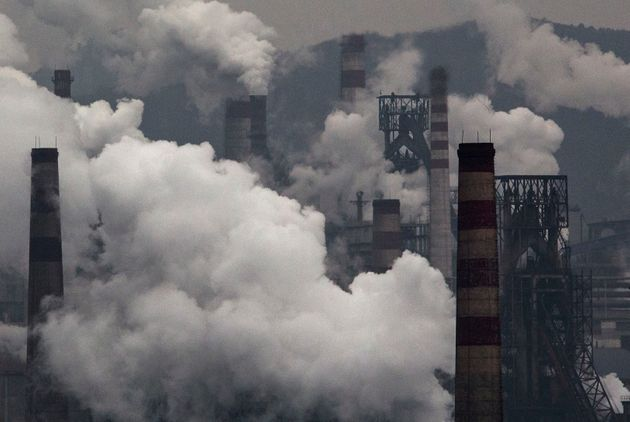 Smoke billows from smokestacks and a coal-fired generator at a steel factory on Nov. 19, 2015, in the...