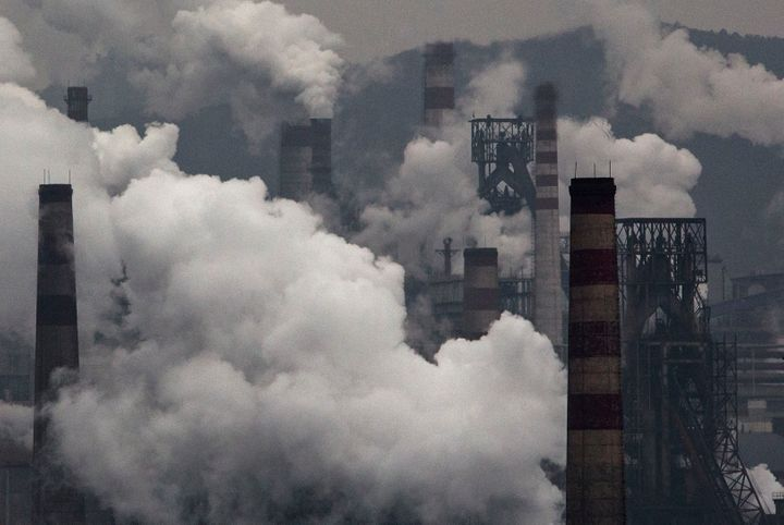 Smoke billows from smokestacks and a coal-fired generator at a steel factory on Nov. 19, 2015, in the industrial province of