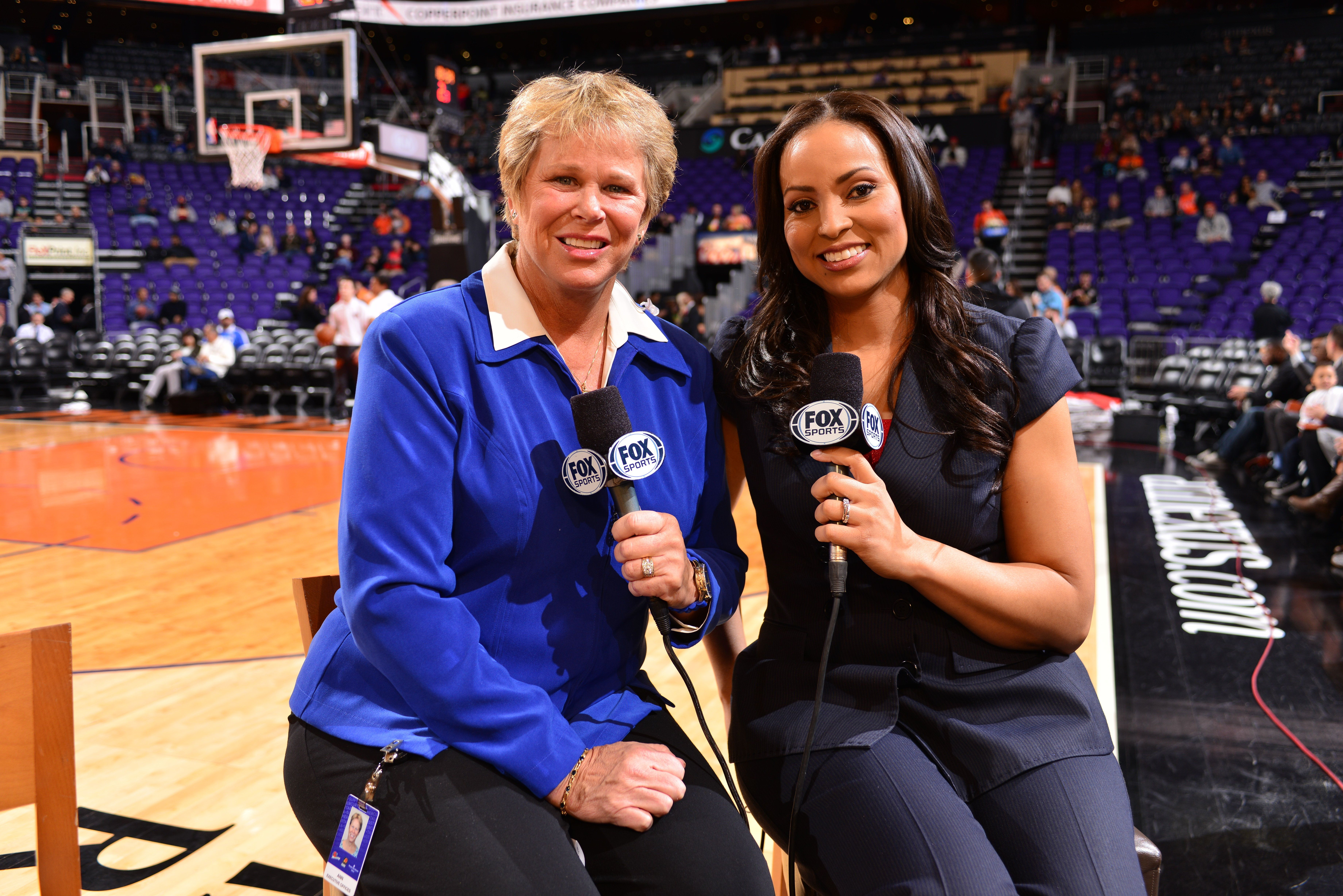 PHOENIX, AZ - JANUARY 6: Ann Meyers Drysdale and  Stephanie Ready are seen before the game between Charlotte Hornets and Phoenix Suns on January 6, 2015, at Talking Stick Resort Arena in Phoenix, Arizona. NOTE TO USER: User expressly acknowledges and agrees that, by downloading and or using this Photograph, user is consenting to the terms and conditions of the Getty Images License Agreement. Mandatory Copyright Notice: Copyright 2016 NBAE (Photo by Barry Gossage/NBAE via Getty Images)