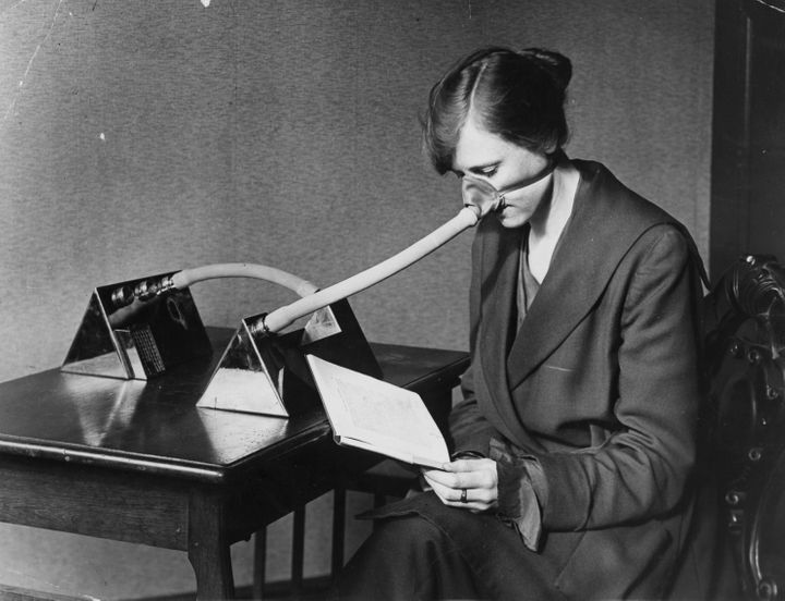 A woman wearing a flu mask during the flu epidemic which followed the First World War, 1919.