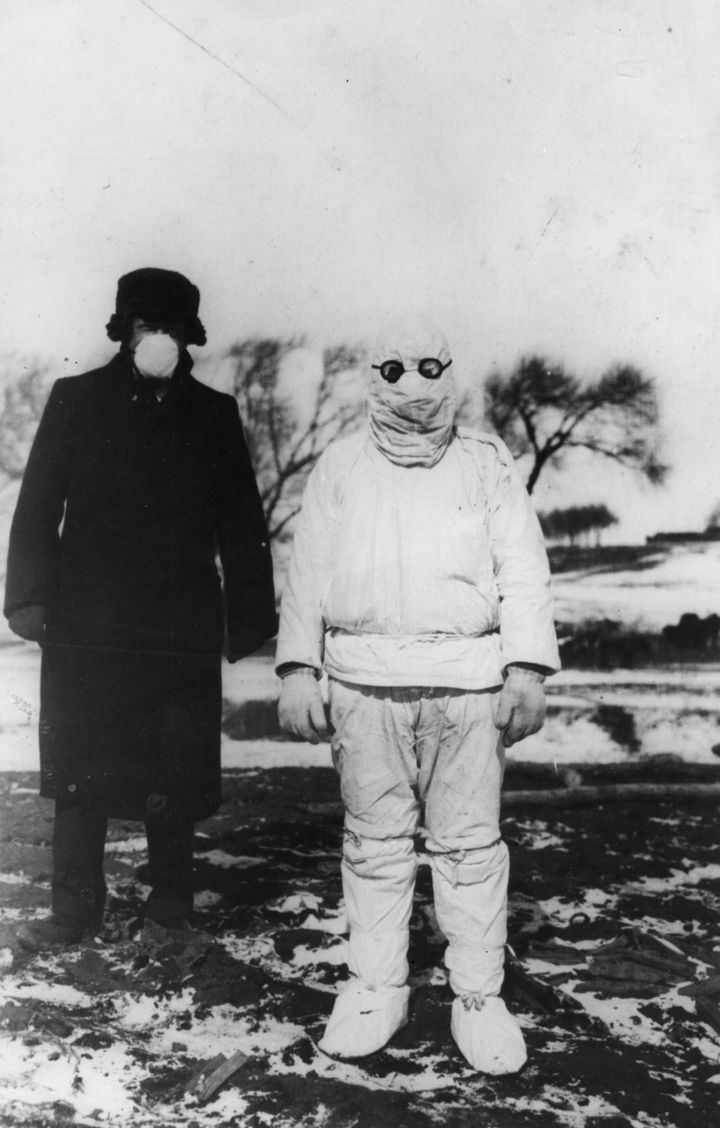 A doctor wears protective clothing during an outbreak of plague in Manchuria, circa 1912.