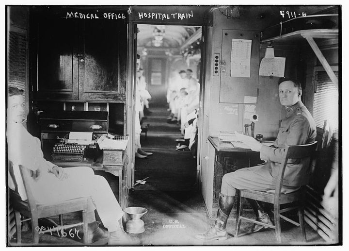 Medical office in a hospital train, circa 1900.