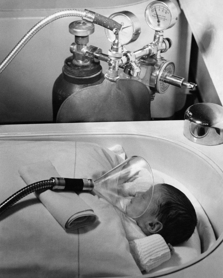 Administering oxygen to a newborn in Berlin, Germany, July 1939.