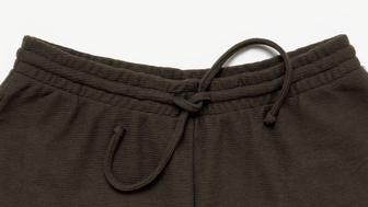 Drawstring waist on trousers, close-up
