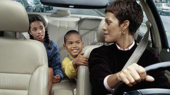 Mother Driving Her Children to School