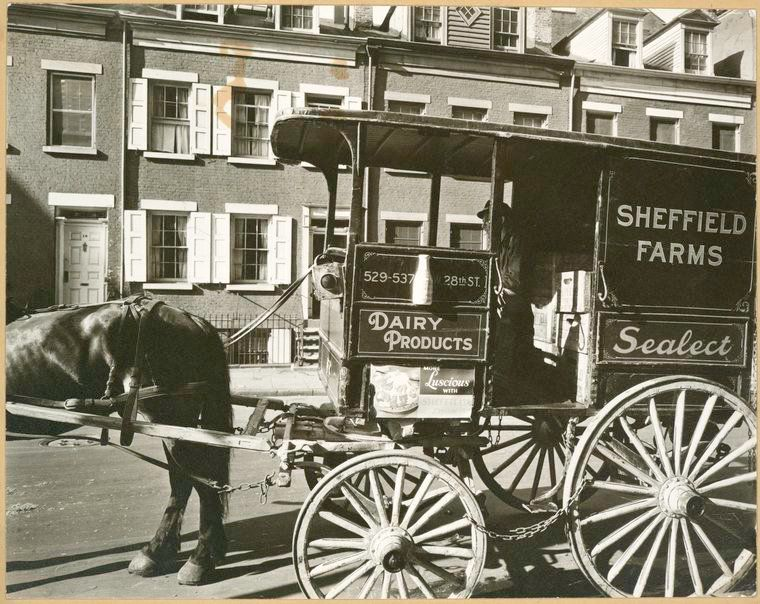 Milk wagon and old houses, Grove Street, Manhattan, in 1935.