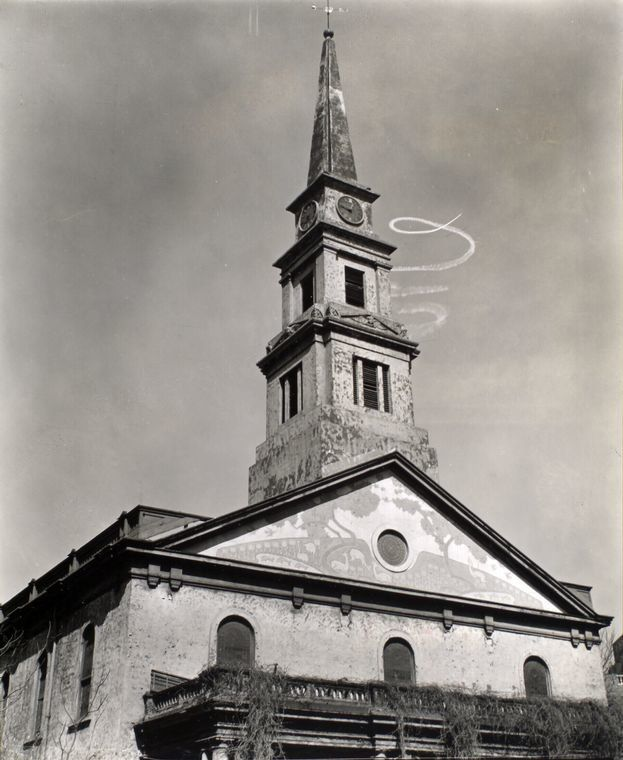 St. Mark's Church on East 10th Street and Second Avenue, Manhattan, with sky-writing in the background, 1935.