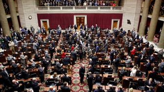 Missouri Gov. Jay Nixon greets lawmakers as he walks into the House chamber to deliver the annual State of the State address to a joint session of the House and Senate, Wednesday, Jan. 21, 2015, in Jefferson City, Mo. (AP Photo/Jeff Roberson)