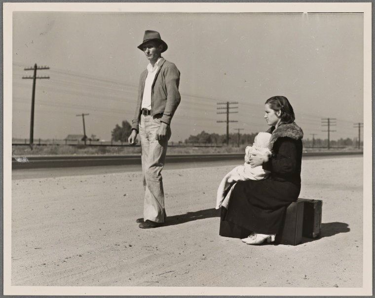 A young, pennilessfamily hitchhiking on U.S. Highway 99, California, in November 1936. The father, 24, and the mother,