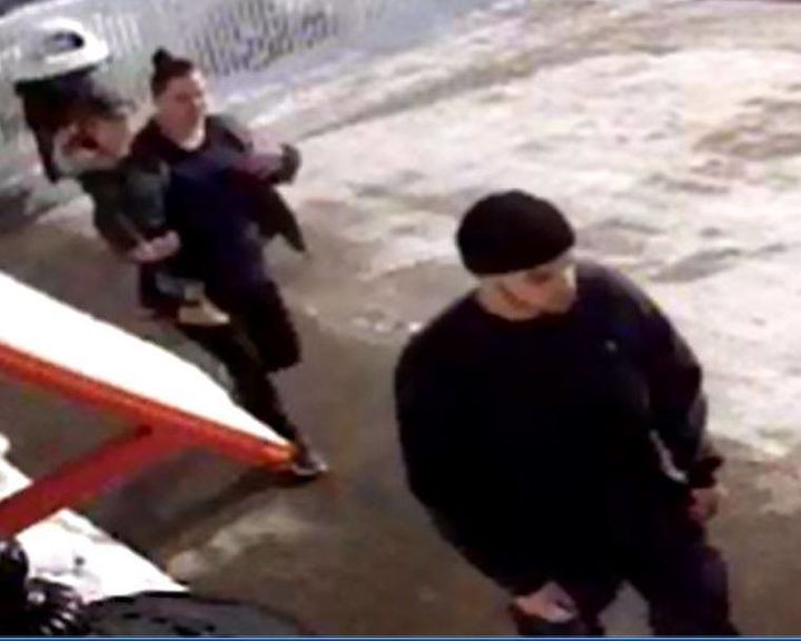Police released video showing the suspect, right, outside the store with a woman and his daughter.