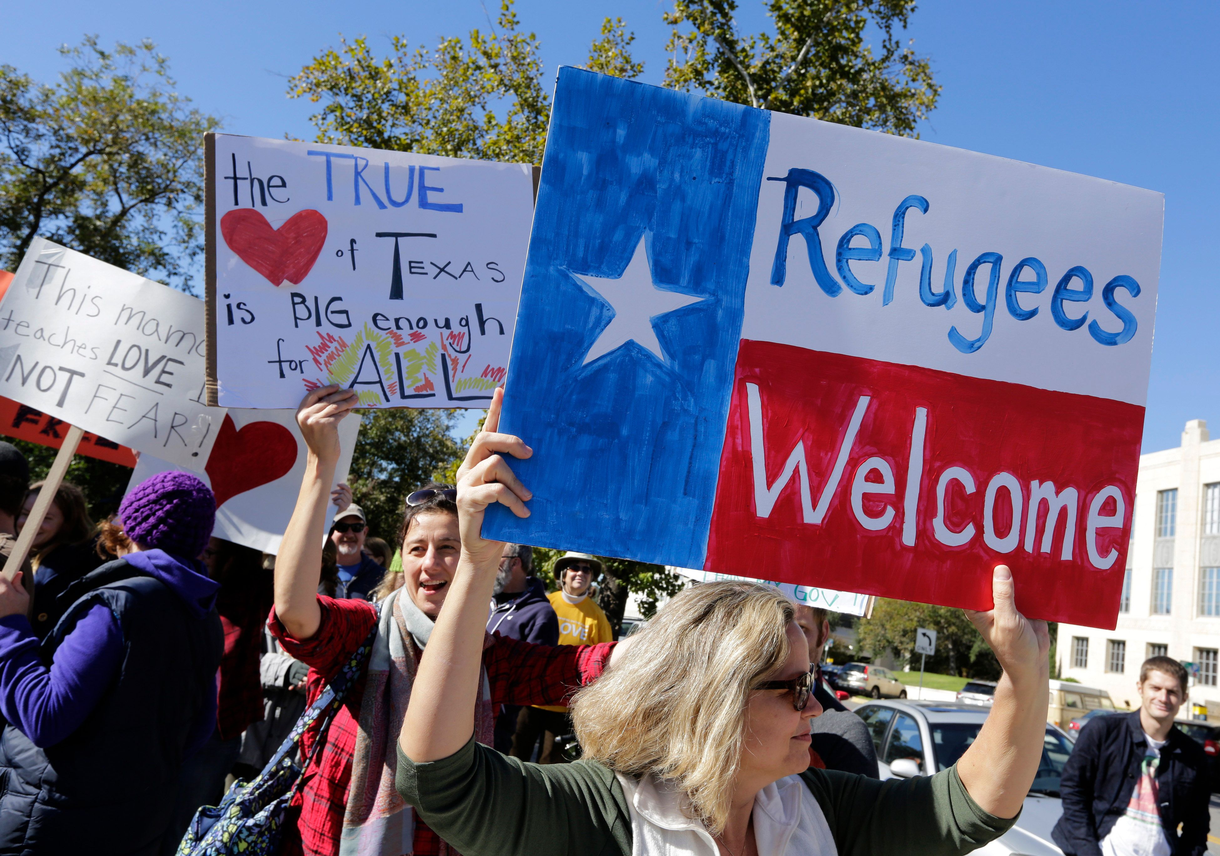 AUSTIN, TX -  NOVEMBER 22: Members of The Syrian People Solidarity Group protest on November 22, 2015 in Austin, Texas. The group was protesting Texas governor Greg Abbott's refusal to allow Syrian refugees in the state. (Photo by Erich Schlegel/Getty Images)