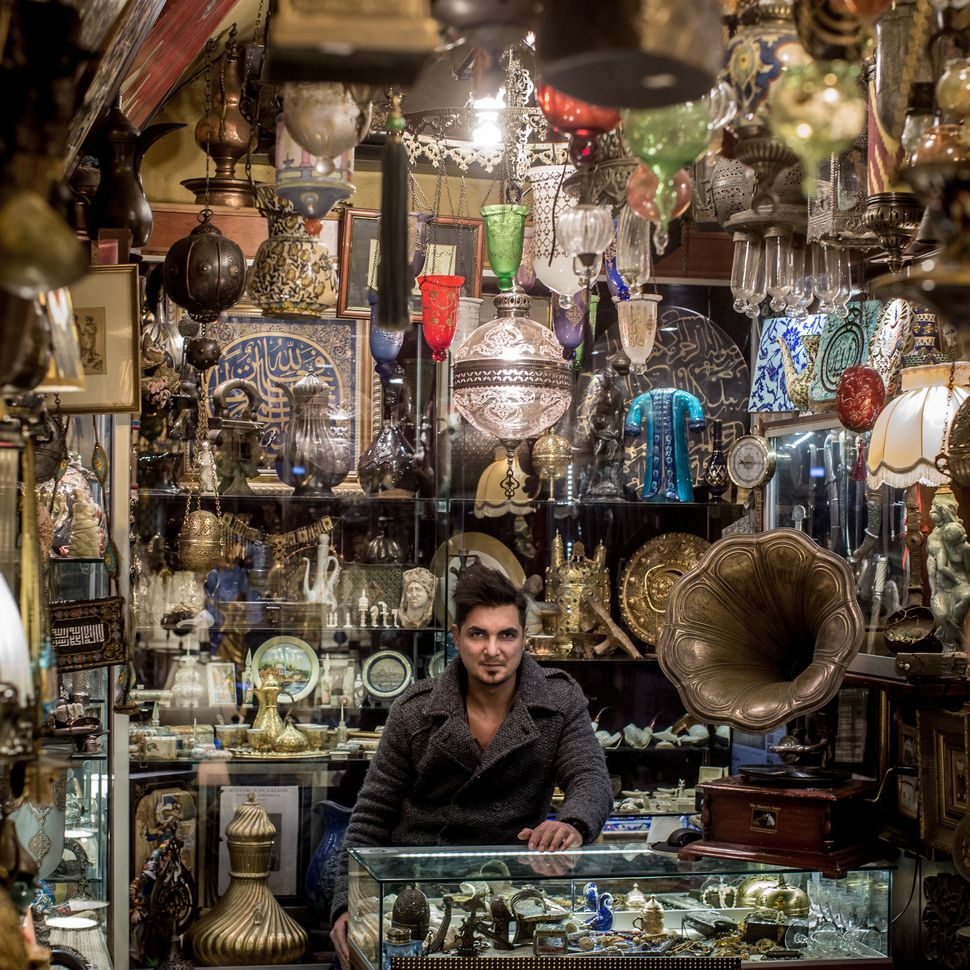 Timur Yildirim poses in his family's store, which sells traditional antiques, on Jan. 7, 2016.