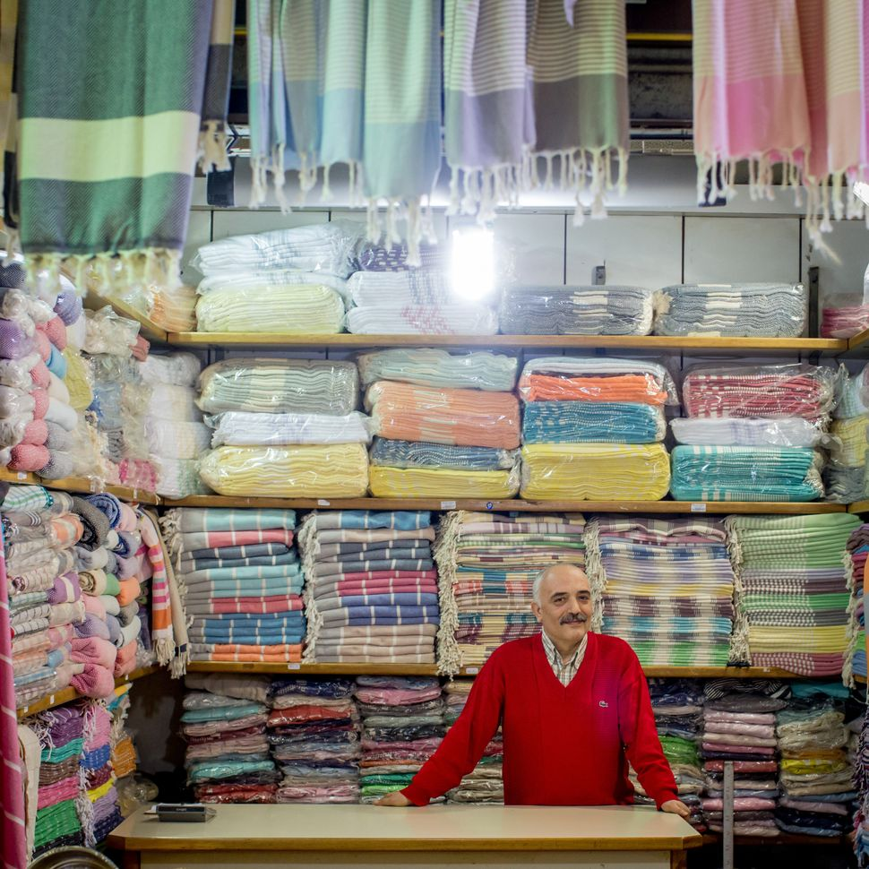 Huseyin Balci stands in his store, which sellstraditional bath towels and fabrics.
