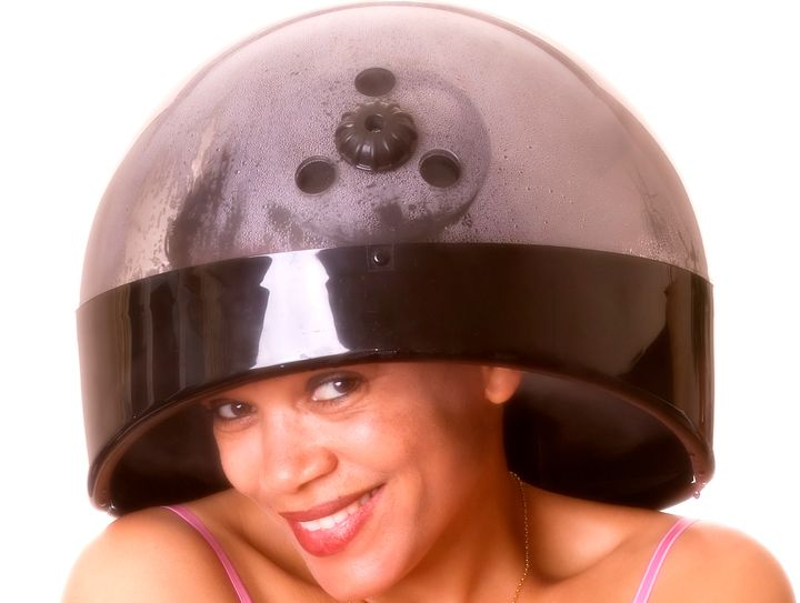 It gets hot underneath a hooded hair steamer. So cover your neck and shoulders with a towel to avoid burns.