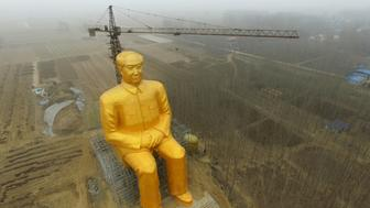 TONGXU, CHINA - JANUARY 04:  (CHINA OUT) A huge statue of Chairman Mao Zedong, 36.6 meters in height, is under construction at Zhushigang village on January 4, 2016 in Tongxu County, China. The statue costs nearly 3 million yuan (459,300 USD) donated by several entrepreneurs and some villagers in Zhushigang village.  (Photo by ChinaFotoPress/ChinaFotoPress via Getty Images)