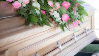 Funeral flowers atop a casket