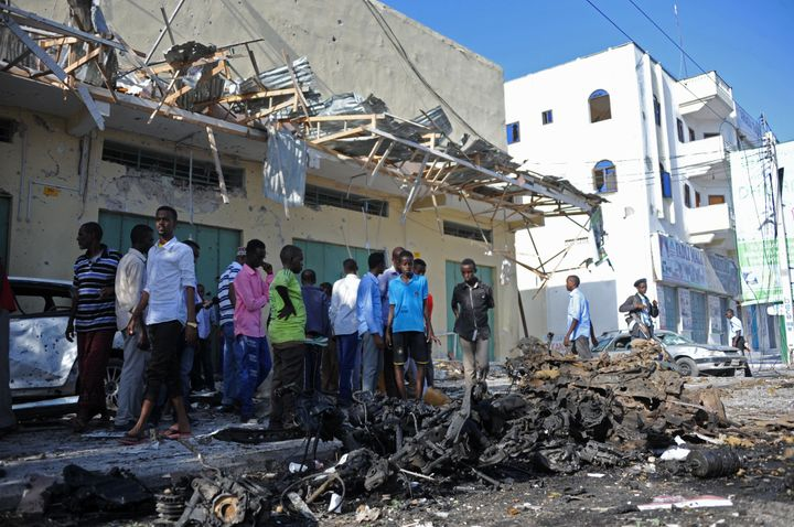 People gather near the site of a bomb blast in the Somali capital last December.