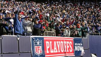 EAST RUTHERFORD, NJ - JANUARY 11: New York Giants fans cheer during the NFC Divisional Playoff game against the Philadelphia Eagles on January 11, 2009 at Giants Stadium in East Rutherford, New Jersey. The Eagles defeated the Giants 23-11. (Photo by Hunter Martin/Getty Images)