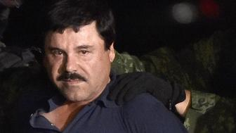 Drug kingpin Joaquin 'El Chapo' Guzman is escorted into a helicopter at Mexico City's airport on January 8, 2016 following his recapture during an intense military operation in Los Mochis, in Sinaloa State. Mexican marines recaptured fugitive drug kingpin Joaquin 'El Chapo' Guzman on Friday in the northwest of the country, six months after his spectacular prison break embarrassed authorities.   AFP PHOTO / OMAR TORRES / AFP / OMAR TORRES        (Photo credit should read OMAR TORRES/AFP/Getty Images)