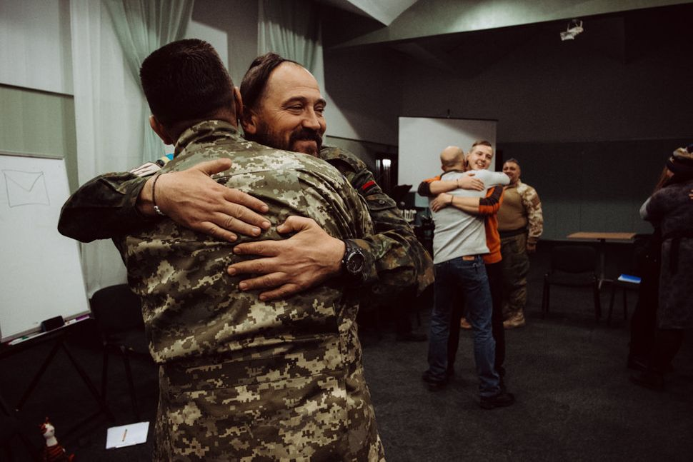 Participants hug at the end of a two-day-long PTSD seminar with Wounded Warrior Ukraine.