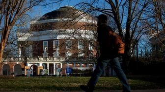 A student walks past the Rotunda, under renovation, on the University of Virginia (UVA) campus in Charlottesville, Virginia, U.S., on Friday, Jan. 16, 2015. This year's rush week at UVA, the prolonged annual rite in which fraternities and sororities recruit new members, carries fresh significance. Depending on who you talk to, the student rituals embody either anÃunchecked culture of sexual violence or a community victimized by stigma and false accusations. Photographer: Andrew Harrer/Bloomberg via Getty Images