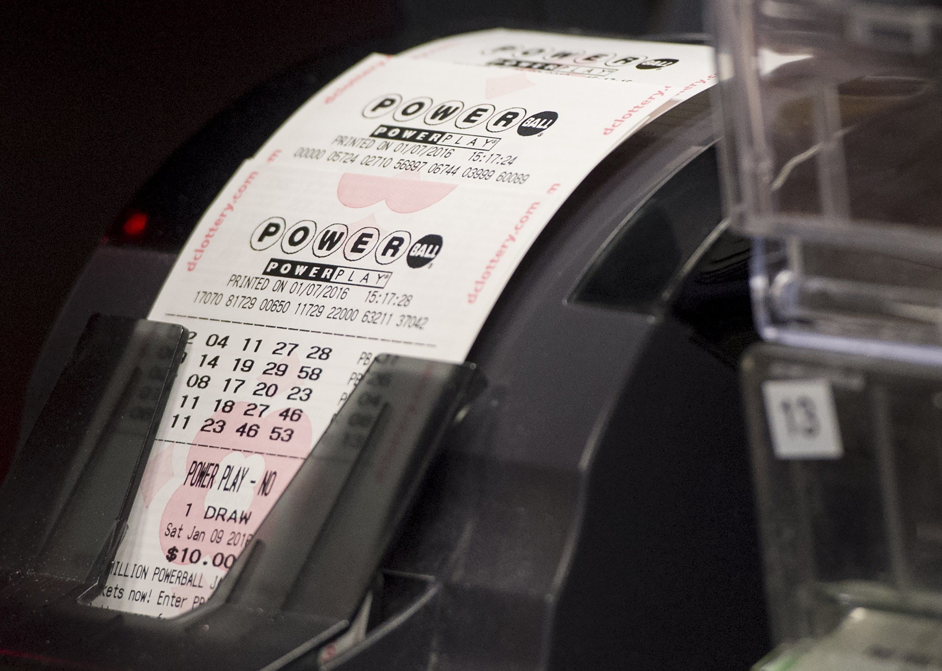A machine prints Powerball lottery tickets at a convenience store in Washington, DC, January 7, 2016. Lottery officials predict Saturday's jackpot will reach $700 million, the largest in history. AFP PHOTO / SAUL LOEB / AFP / SAUL LOEB        (Photo credit should read SAUL LOEB/AFP/Getty Images)