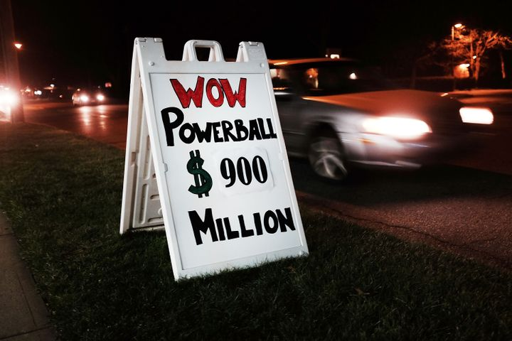A sign outside of a Connecticut gas station displays Saturday night's potential winnings in the Powerball lottery