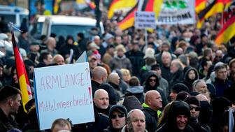 COLOGNE, GERMANY - JANUARY 09:  Supporters of Pegida, Hogesa (Hooligans against Salafists) and other right-wing populist groups gather to protest against the New Year's Eve sex attacks on January 9, 2016 in Cologne, Germany. Over 100 women have filed charges of sexual molestation, robbery and in two cases, rape, stemming from aggressive groping and other behavior by gangs of drunken men described as Arab or North African at Hauptbahnhof on New Year's Eve. Over 100 women have filed charges of sexual molestation, robbery and in two cases, rape, stemming from aggressive groping and other behavior by gangs of drunken men described as Arab or North African at Hauptbahnhof on New Year's Eve. Police have recently stated that at least some of the men identified so far are refugees, which is feeding the propaganda of right-wing groups opposed to Germany's open-door refugee policy. Germany took in approximately 1.1 million migrants and refugees in 2015.  (Photo by Sascha Schuermann/Getty Images)