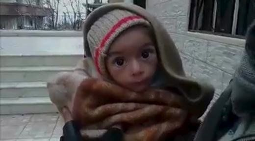 A toddler is held up to the camera in this still image taken from video said to be shot in Madaya on January 5, 2016.