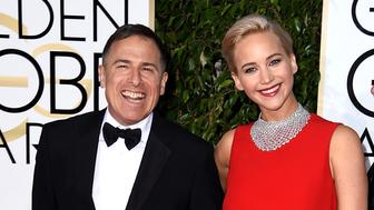 BEVERLY HILLS, CA - JANUARY 10:  Filmmaker David O. Russell (L) and actress Jennifer Lawrence attend the 73rd Annual Golden Globe Awards held at the Beverly Hilton Hotel on January 10, 2016 in Beverly Hills, California.  (Photo by Steve Granitz/WireImage)