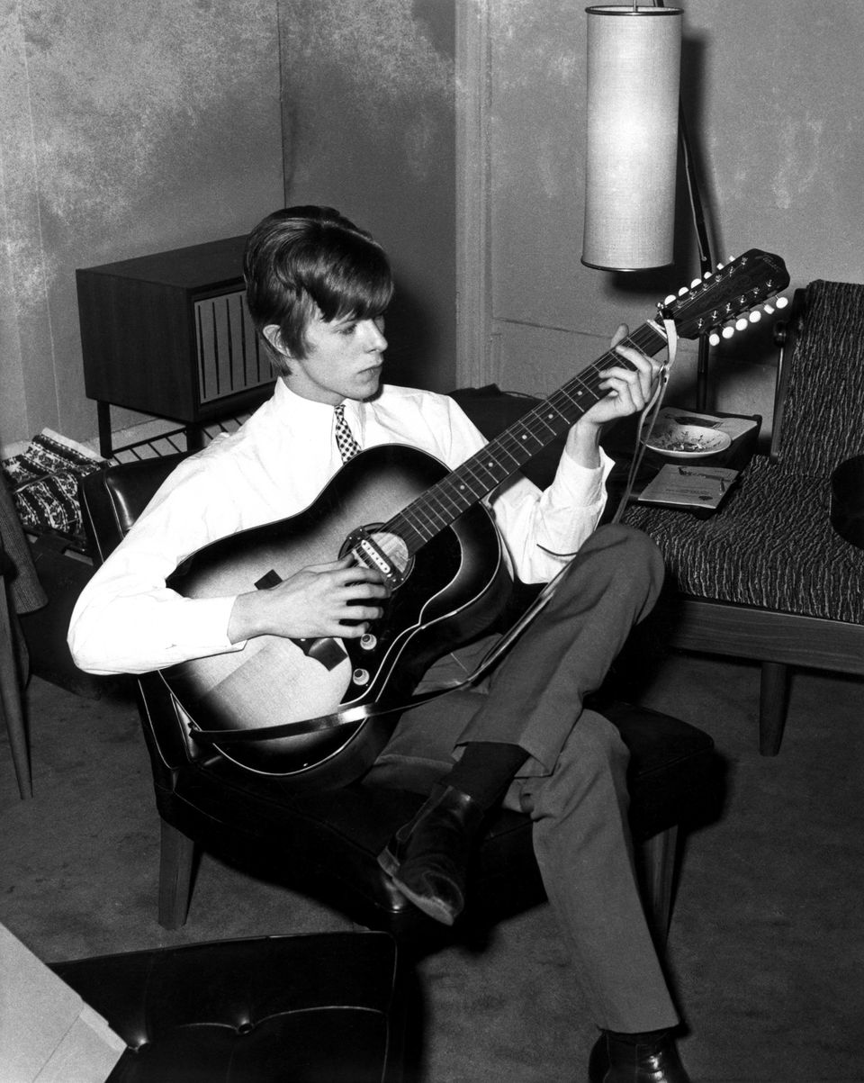 Photo of David BOWIE; Davie Jones (Davy Jones), posed, c.1965, playing Framus 12 string acoustic guitar.