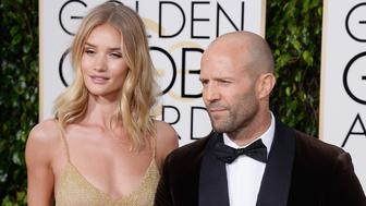 BEVERLY HILLS, CA - JANUARY 10:  73rd ANNUAL GOLDEN GLOBE AWARDS -- Pictured: Actress Rosie Huntington-Whiteley (L) and Jason Statham arrive to the 73rd Annual Golden Globe Awards held at the Beverly Hilton Hotel on January 10, 2016.  (Photo by Kevork Djansezian/NBC/NBCU Photo Bank via Getty Images)
