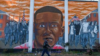 BALTIMORE, MD NOVEMBER 15: A mural depicting Freddie Gray and the uprisings following the death of Freddie Gray in the custody of Baltimore police sits on N. Mount Street in the Sandtown-Winchester neighborhood of West Baltimore on Sunday, November 15, 2015, in Baltimore, MD.   (Photo by Jahi Chikwendiu/The Washington Post via Getty Images)