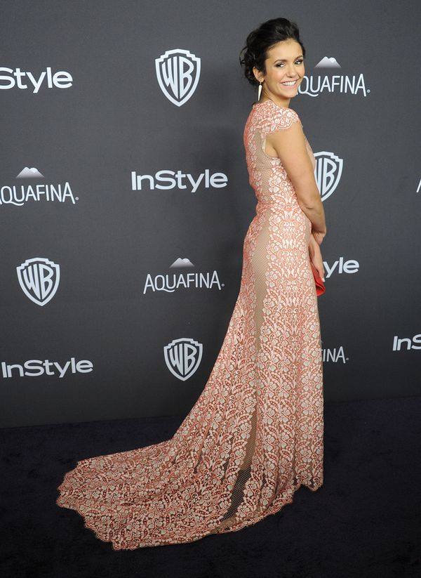 BEVERLY HILLS, CA - JANUARY 10: Actress Nina Dobrev arrives at the 2016 InStyle And Warner Bros. 73rd Annual Golden Globe Awa