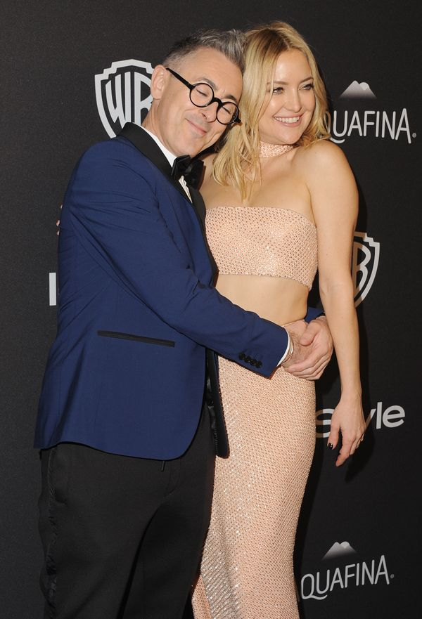 BEVERLY HILLS, CA - JANUARY 10:  Actor Alan Cumming and actress Kate Hudson arrive at the 2016 InStyle And Warner Bros. 73rd