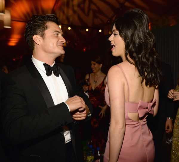 BEVERLY HILLS, CA - JANUARY 10:  Actor Orlando Bloom (L) and singer Katy Perry attend The Weinstein Company and Netflix Golde