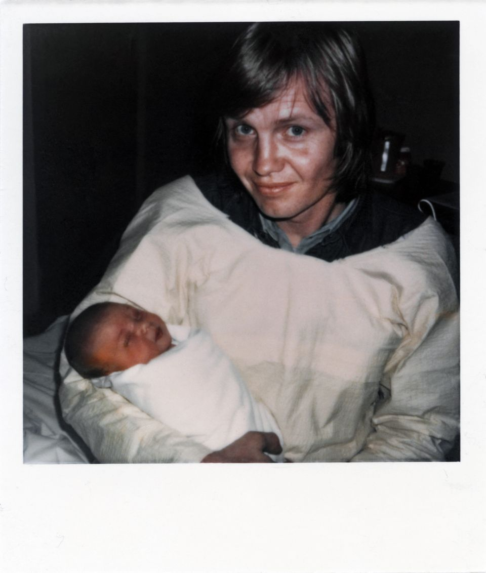 LOS ANGELES - JUNE 4:  Actor Jon Voight holds his new born baby Angelina Jolie Voight (only 4 hours old) on June 4, 1975 in L