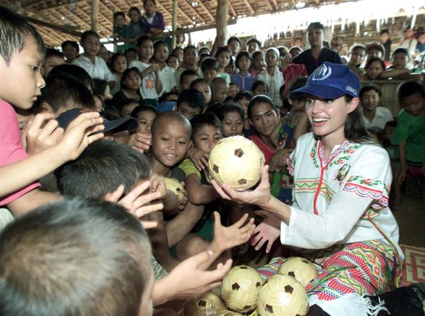 THAM HIN, THAILAND - MAY 20:  Hollywood actress Angelina Jolie distributes balls to the children at the Tham Hin refugee camp